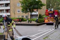 Brandmän med lastbilen, Sverige Royaltyfri Foto