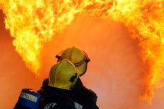 Brandmän med slangen Royaltyfria Foton