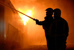 Brandmän på arbete Royaltyfria Foton