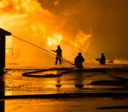 Brandmän på arbete Fotografering för Bildbyråer