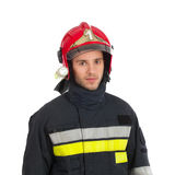 Brandman i röd hjälm royaltyfria foton