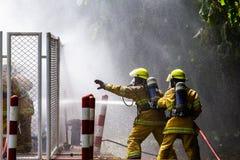 Brandman på branden fotografering för bildbyråer