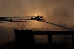 Brandman på stege II fotografering för bildbyråer