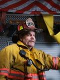 Brandman Portrait i deltagandekugghjul Arkivfoton