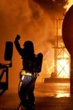 Brandmannen på avfyrar Arkivbilder