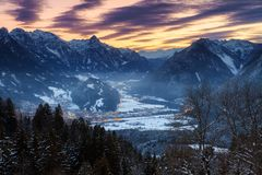 Brandnertal dark winter sunset. Beautiful winter evening sunset view of the city Brand in the valley of the Brandnertal in the mountains of the Alps in royalty free stock images