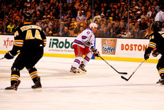 Brandon Dubinsky trying to get past Bruins Defense Royalty Free Stock Images