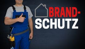 Brandschutz in german Fire safety concept and craftsman with t. Humbs up stock photo