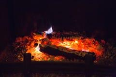 Brandvlammen met as in open haard Royalty-vrije Stock Foto