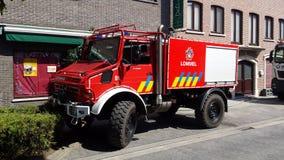 Brandweer lommel juni. Unimog Mercedes red Stock Photography