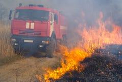 Brandweerauto en Vlam 4 Stock Foto's