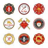 Brandweerkorpsemblemen Stock Foto's