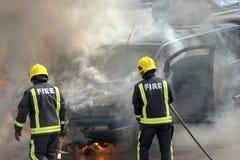 Brandweerlieden in actie! Royalty-vrije Stock Afbeeldingen