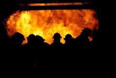 Brandweerlieden in de brand Stock Foto