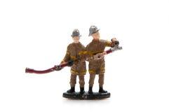 Brandweerliedenstuk speelgoed Stock Foto