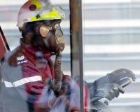 Brandweerman in beschermend kostuum tijdens NDP 2009 Royalty-vrije Stock Afbeeldingen