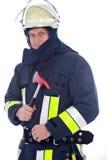 Brandweerman die een rode brandbijl houden Stock Foto