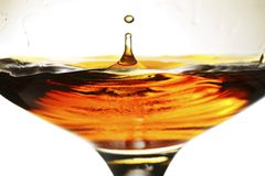 Brandy. Splash in a snifter glass Royalty Free Stock Photography