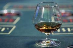Brandy alla tavola della mazza Fotografia Stock