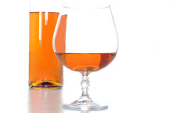 Brandy bootle and glass Stock Photography