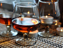 Brandy and candles Royalty Free Stock Image