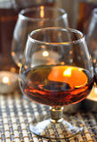 Brandy and candles Royalty Free Stock Photography