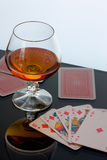Brandy and cards. Background can use the Internet, print advertising and design Stock Photos
