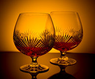 Brandy Cognac. Two cut glass brandy glasses in low light Stock Photography