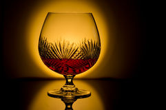 Brandy Cognac. Brandy snifter backlit with low light Stock Images