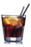 Brandy with cola cocktail. Summer refreshing cocktail with straws Royalty Free Stock Image