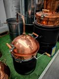 Brandy distillation boiler. Detail of alcohol distillation boiler in a store Royalty Free Stock Images