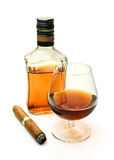 Brandy in a glass and a bottle with a cigar Royalty Free Stock Image