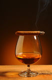Brandy Glass with Cigar Royalty Free Stock Image