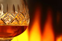 Brandy in glass with fire A Royalty Free Stock Photo