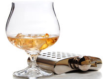 Brandy glass and hip flask Stock Photos