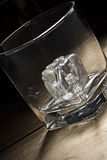 Brandy glass with ice cube Stock Photography