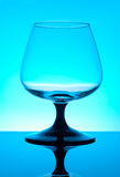 Brandy glass isolated on blue background Royalty Free Stock Image