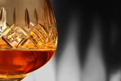 Brandy in glass selective color Stock Photos