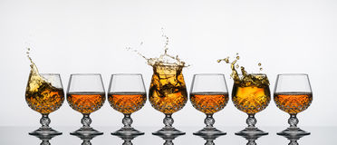 Brandy Glass Splash Stock Photo