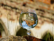 Brandy glass with water on the ruins. Of the manor Stock Images