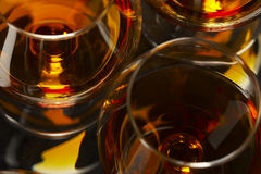 Brandy glasses. Closeup of brandy glasses with alcohol royalty free stock photo