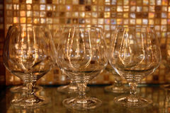 Brandy glasses against restaurant bar background stock photo