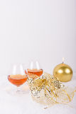 Brandy glasses with golden candle and decoration Stock Photos