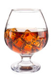 Brandy with ice in goblet Stock Photography