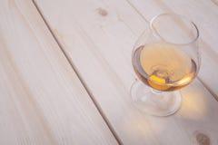 Brandy on light wood Stock Image