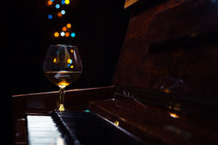 Brandy on a old piano Royalty Free Stock Images