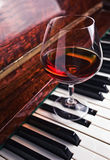 Brandy on old piano Royalty Free Stock Image