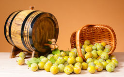Brandy and plums with a barell Stock Photos