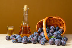 Brandy and plums Royalty Free Stock Photos