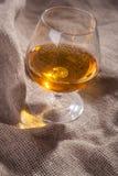 Brandy on sackcloth Royalty Free Stock Photos